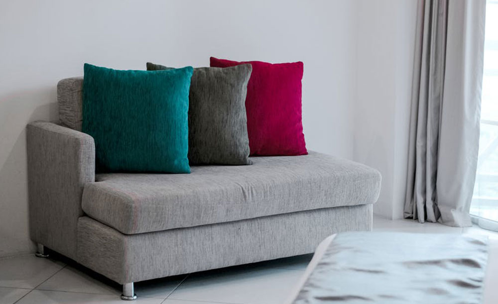 A photo of a sofa covered in upholstry